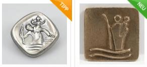 Christophorus Schlüsselanhänger/Autoanhänger als Geschenk - Eine Nahaufnahme eines Geräts - Bronze