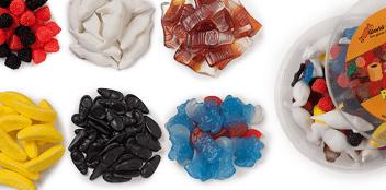 Süßwaren bzw. Süßigkeiten verschenken – leckeres Geschenk - Ein Kuchen mit Obst auf einem Tisch - Süßwaren